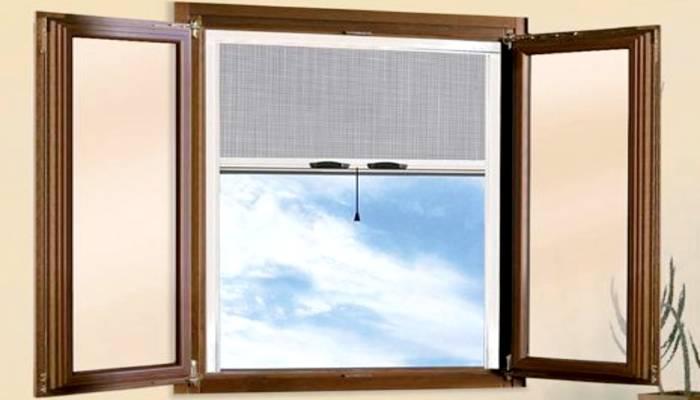 Zanzariere a rullo verticale per finestre foto